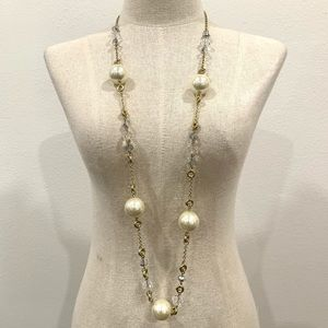 Long gold pearl statement necklace